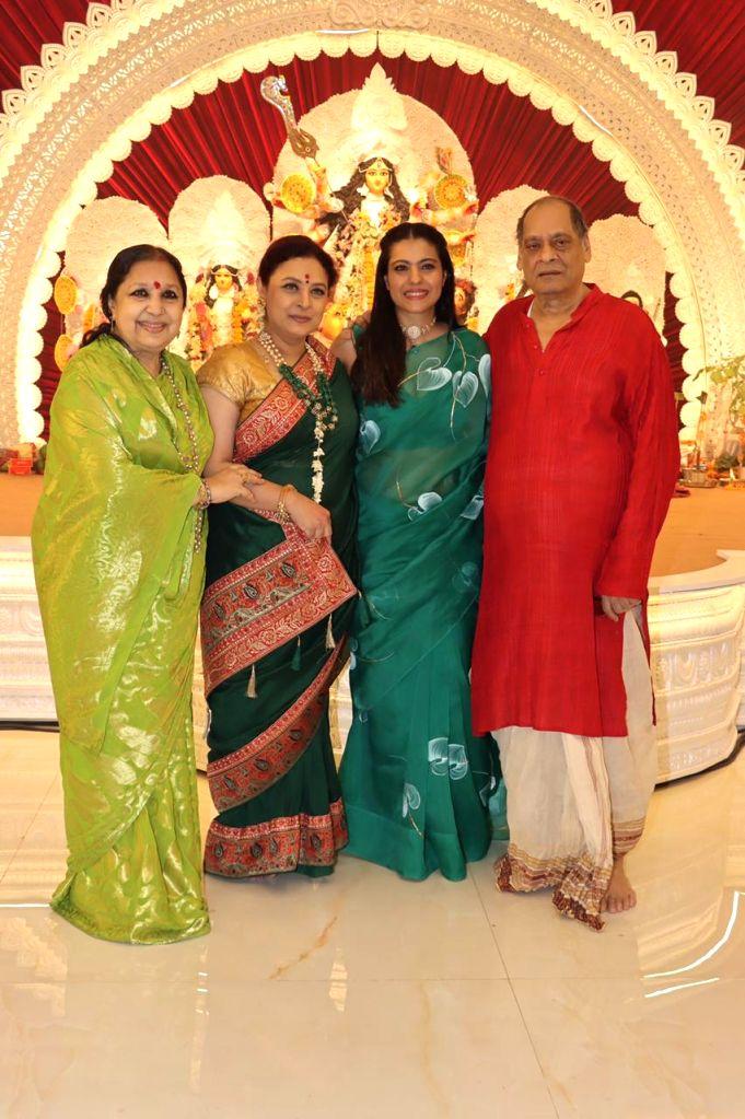 Bollywood Actress Kajol with Uncle Deb Kukherjee and Sharbani Mukherjee At North Bombay Durga Puja Samiti on the occasion of Maha Navami in Mumbai on Thursday October 14, 2021. - Kajol and Sharbani Mukherjee A