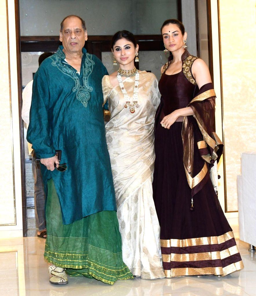 Bollywood Actress Mouni Roy with Deb Mukherjee attents the North Bombay Sarbojanin Durga Puja Samiti on the Occasion of Maha Ashtami in Mumbai on Wednesday October 13,2021. - Mouni Roy and Mukherjee