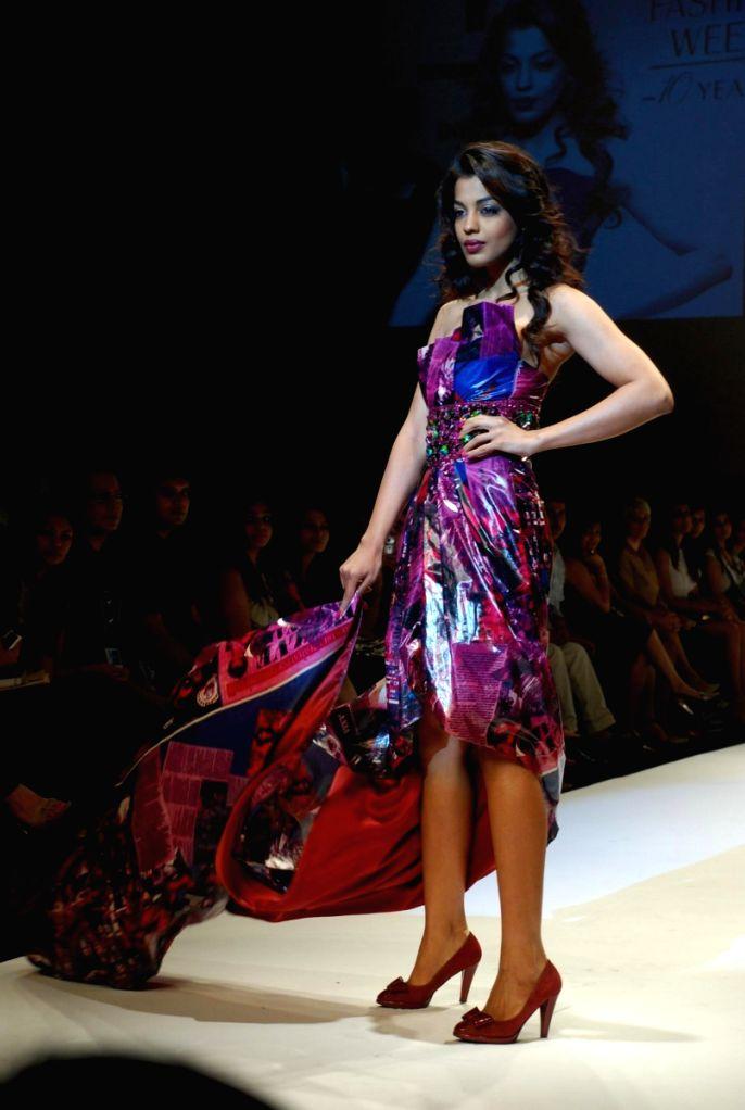 Bollywood actress Mugdha Godse walks the ramp for fashion designer Narendra Kumar at the ongoing autumn/winter edition of Lakme India Fashion Week in Mumbai. - Mugdha Godse and Narendra Kumar