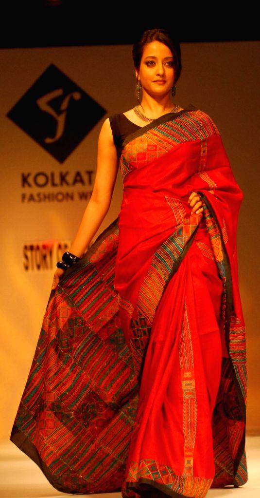 Bollywood actress Raima Sen walks at the ramp during the Kolkata Fashion Week 2nd April 2009. - Raima Sen