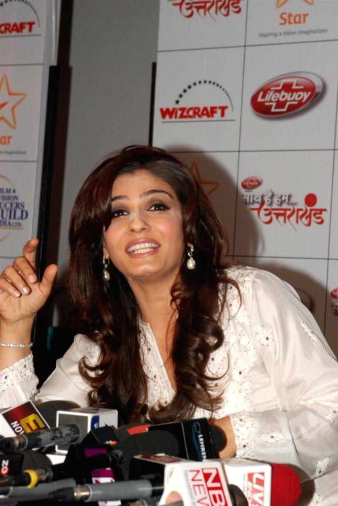 Bollywood actress Raveena Tondon during the Star India`s `Saath Hain Hum Uttarakhand` 7-hour programme in Mumbai on August 15, 2013. (Photo::: IANS) - Raveena Tondon