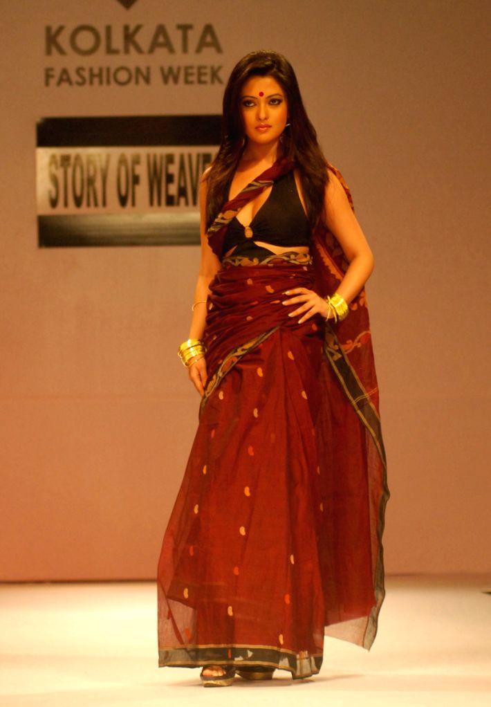 Bollywood actress Riya Sen walks the ramp during the Kolkata Fashion Week on 3rd April 2009.