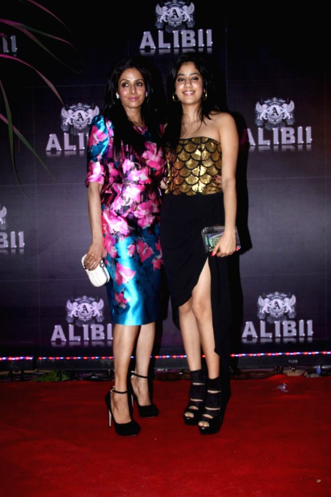 Bollywood actress Sridevi with daughter Jahnavi during the celebration of her 50th birthday in Mumbai on August 17, 2013. Filmmaker Boney Kapoor has thrown a lavish party to celebrate his Bollywood .. - Kapoor