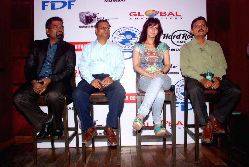 Bollywood actress Tulip Joshi Launches Football Marathon 2012 at Hard Rock Cafe. - Tulip Joshi Launches Football Marathon