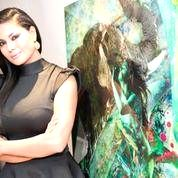 Bollywood actress Veena Malik who is in London to be a part of art exhibition where she posed as a canvas for Finland-based artist Vesa Kivinen for some breathtaking body art. (Photo::: IANS)