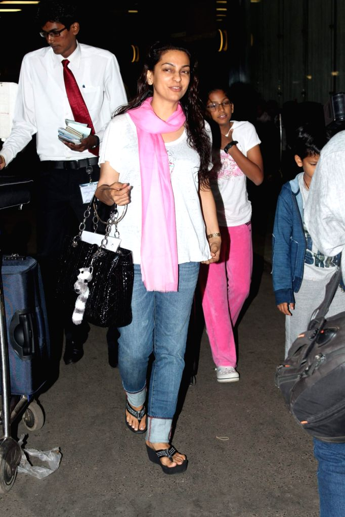 Bollywood celebrities Juhi Chawla snapped at airport leaving for London. - Juhi Chawla