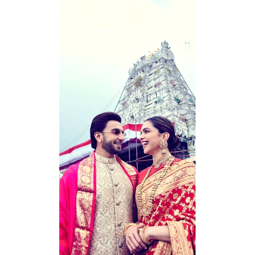 Bollywood couple Deepika Padukone and Ranveer Singh started celebrations of their first wedding anniversary on November 14 by visiting Lord Venkateswara temple. While Deepika wore a red saree with gold zari work, Ranveer looks dapper in a bandhgala b - Deepika Padukone and Ranveer Singh