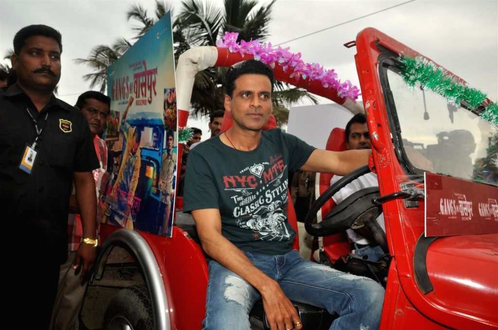 Bollywood director Anurag Kashyap and actor Manoj Bajpai were spotted at the music launch of their upcoming movie `Gangs Of Wasseypur` on the streets of Mumbai. - Manoj Bajpai and Anurag Kashyap