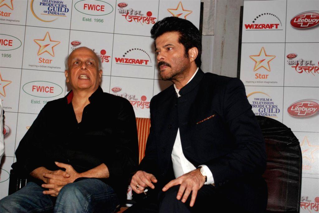 Bollywood filmmaker Mahesh Bhatt and actor Anil Kapoor during the Star India`s `Saath Hain Hum Uttarakhand` 7-hour programme in Mumbai on August 15, 2013.  (Photo::: IANS) - Anil Kapoor