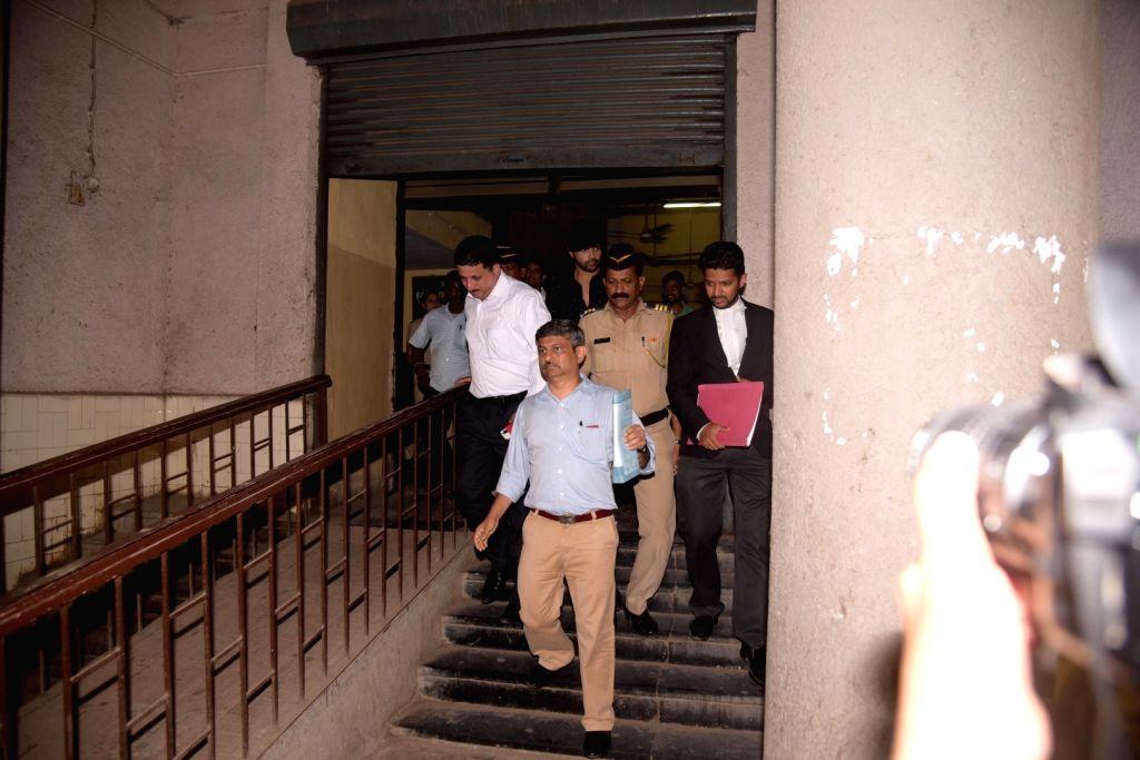 Bollywood music composer and actor Himesh Reshammiya leaves from Bandra family court, in Mumbai, on June 7, 2017. - Himesh Reshammiya