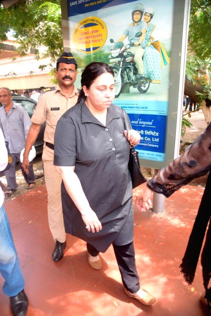 Bollywood music composer and actor Himesh Reshammiya's wife Komal leaves from Bandra family court, in Mumbai, on June 7, 2017. - Himesh Reshammiy