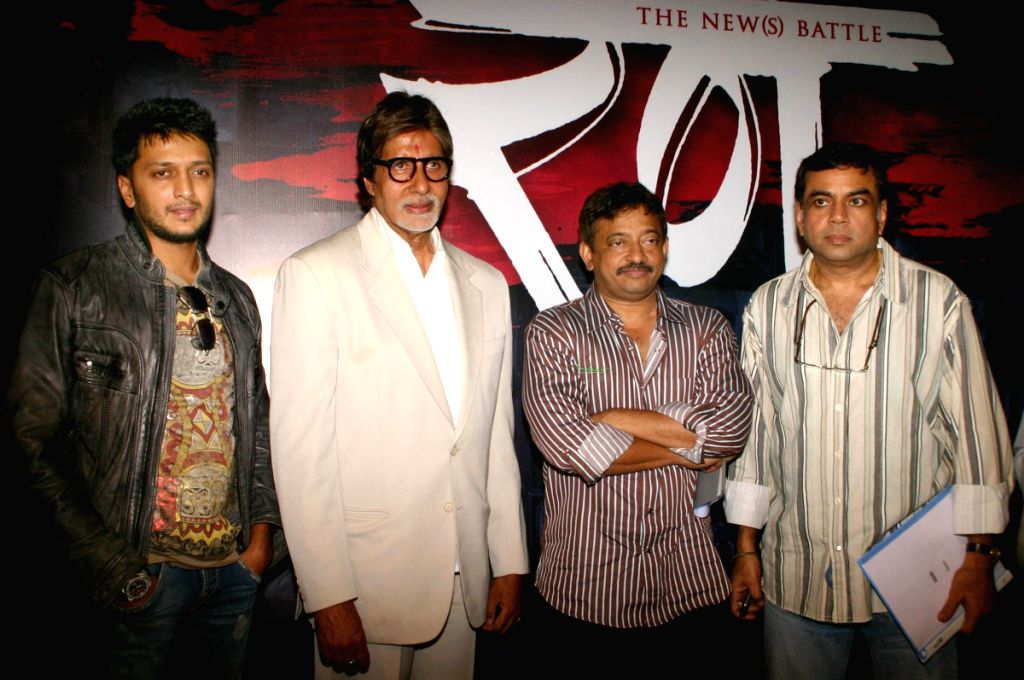 "Bollywood star Amitabh Bachchan with director Ram Gopal Verma, actors Ritesh Deshmukh and  Paresh Rawal at a press-meet for the film ""Rann"" in New Delhi on Wednesday."