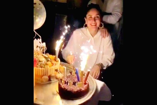 "Bollywood star Kareena Kapoor cut the birthday cake on September 21. In a viral video, Kareena's husband Saif Ali Khan, son Taimur and sister Karisma Kapoor are among guests wishing the ""Veere Di Wedding"" actress. - Kareena Kapoor, Saif Ali Khan and Karisma Kapoor"