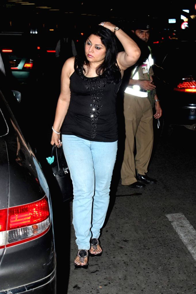 Bollywood stars at International Airport leave for IIFA.