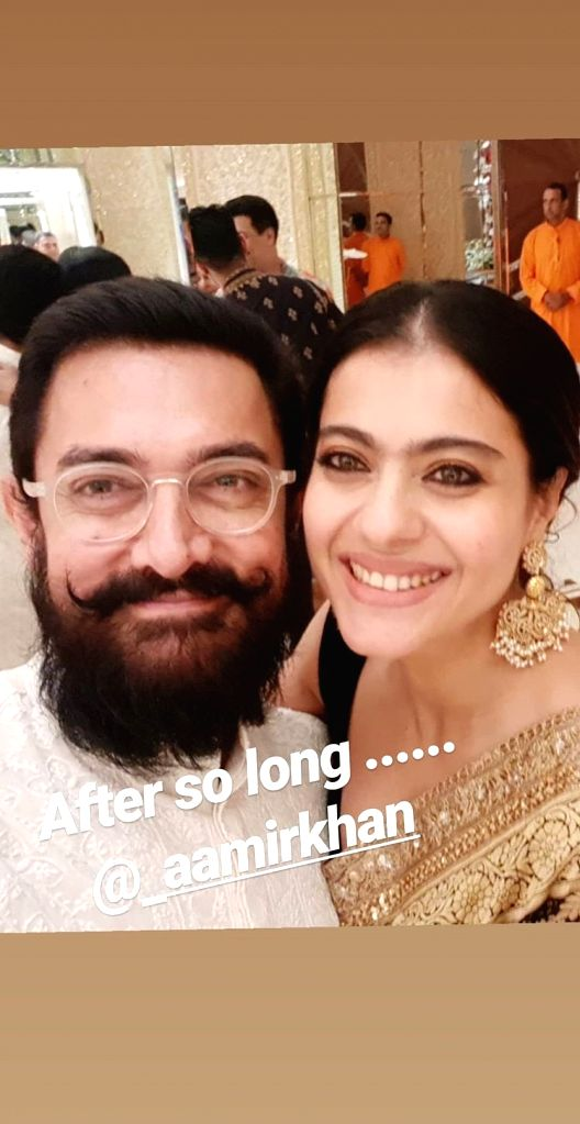 "Bollywood stars Kajol and Aamir Khan were thrilled to meet ""after so long"" at industrialist Mukesh Ambani's Ganesh Chaturthi celebrations in his Mumbai home, Antilia. - Kajol, Aamir Khan and Mukesh Ambani"