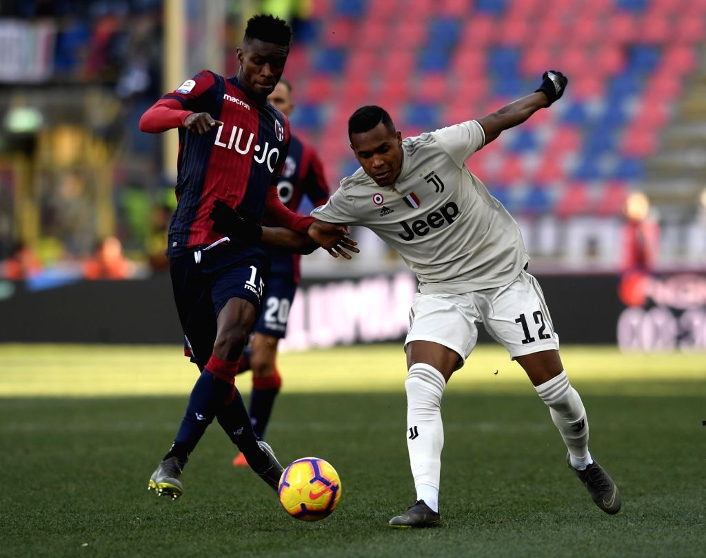 BOLOGNA, Feb. 25, 2019 - Juventus's Alex Sandro (R) vies with Bologna's Ibrahima Mbaye during a Serie A soccer match between Bologna and FC Juventus in Bologna, Italy, Feb. 24 , 2019. FC Juventus won ...