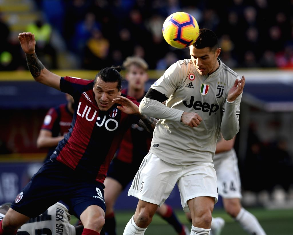 BOLOGNA, Feb. 25, 2019 - Juventus's Cristian Ronaldo (R) vies with Bologna's Federico Santander during a Serie A soccer match between Bologna and FC Juventus in Bologna, Italy, Feb. 24 , 2019. FC ...