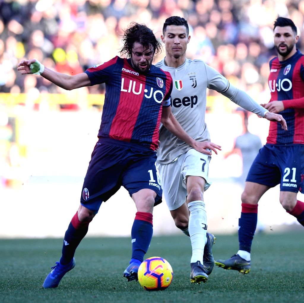 BOLOGNA, Feb. 25, 2019 - Juventus's Cristiano Ronaldo (R) vies with Bologna's Andrea Poli during a Serie A soccer match between Bologna and FC Juventus in Bologna, Italy, Feb. 24, 2019. FC Juventus ...