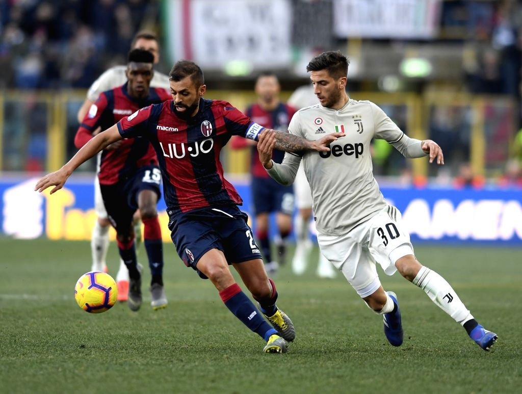 BOLOGNA, Feb. 25, 2019 - Juventus's Rodrigo Bentancur (R) vies with Bologna's Larangeira Danilo during a Serie A soccer match between Bologna and FC Juventus in Bologna, Italy, Feb. 24 , 2019. FC ...