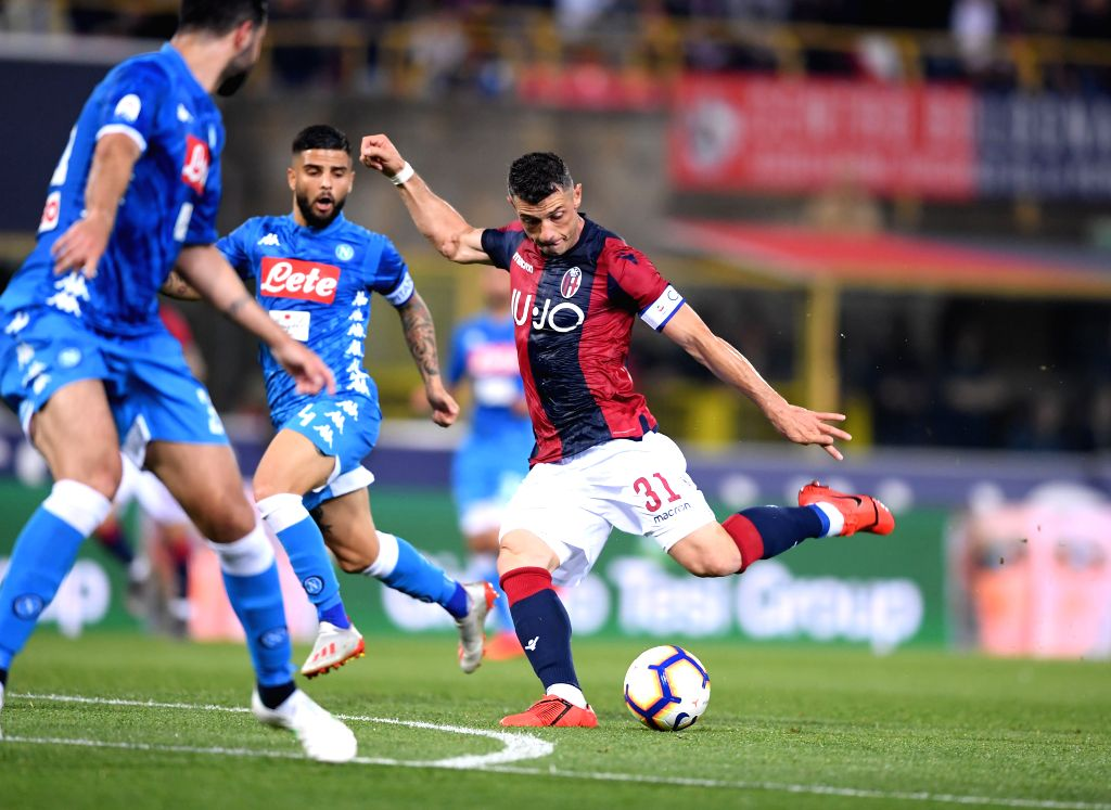 BOLOGNA, May 26, 2019 - Bologna's Blerim Dzemaili(L) scores his goal during a Serie A soccer match between Bologna and Napoli in Bologna, Italy, May 25, 2019. Bologna won 3-2.