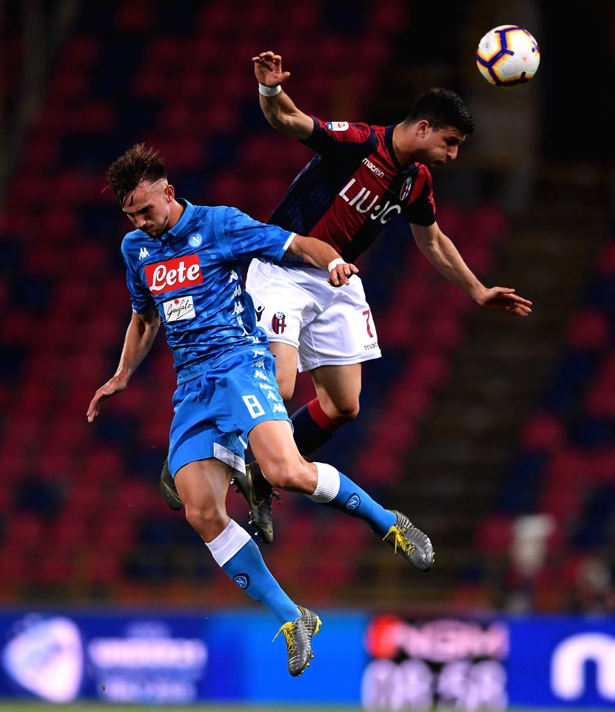 BOLOGNA, May 26, 2019 - Bologna's Riccardo Orsolini (R) vies with Napoli's Fabian Ruiz during a Serie A soccer match between Bologna and Napoli in Bologna, Italy, May 25, 2019. Bologna won 3-2.