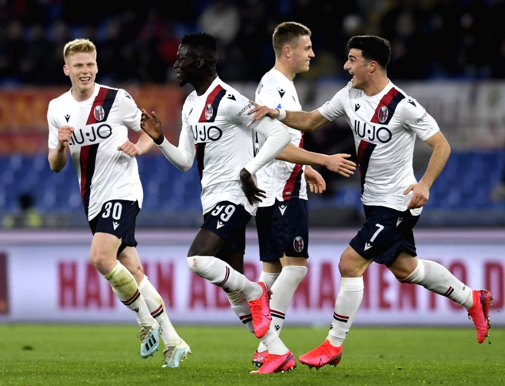 Bologna's Musa Barrow (2nd L) celebrates with his teammates after scoring a goal during a Serie A soccer match between Roma and Bologna in Rome, Italy, Feb. 7, 2020.