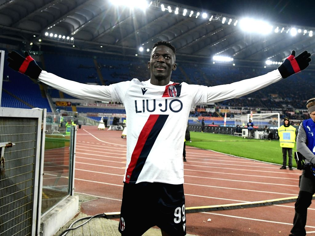 Bologna's Musa Barrow celebrates scoring during a Serie A soccer match between Roma and Bologna in Rome, Italy, Feb. 7, 2020.