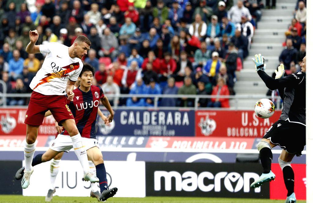 BOLOGNA, Sept. 23, 2019 - Roma's Edin Dzeko (L) scores his goal during a Serie A soccer match between Bologna and Roma in Bologna, Italy, Sept. 22, 2019.