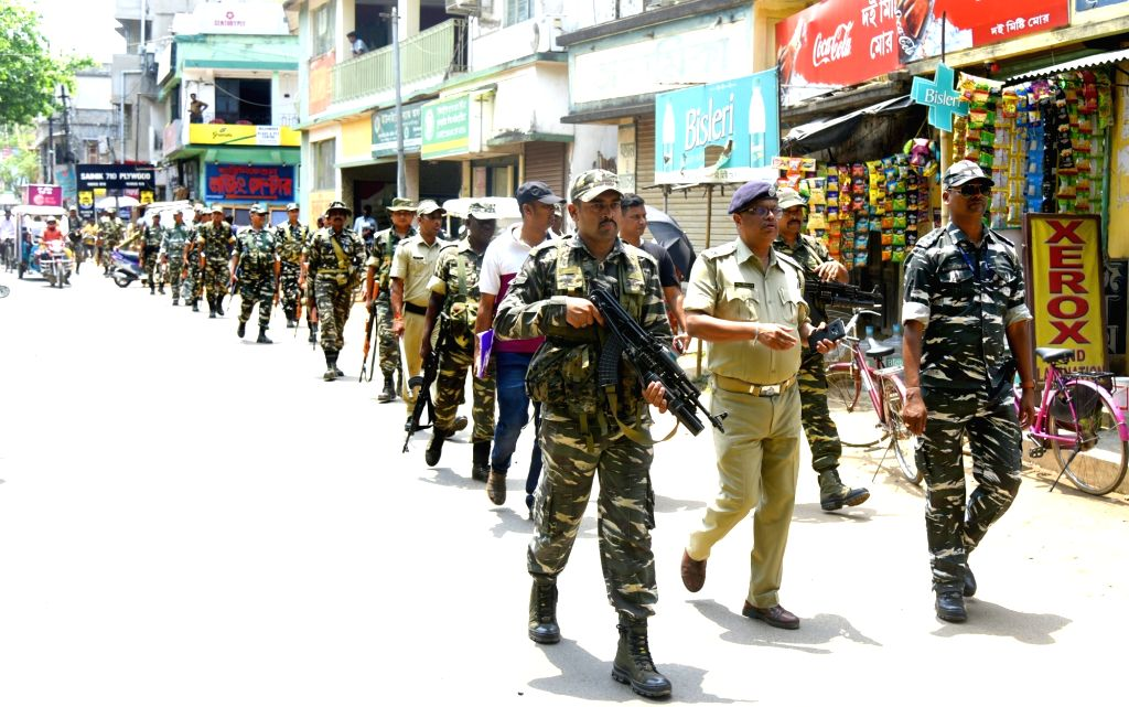 Bolpur (West Bengal): Police and CRPF personnel conduct a route march ahead of the fourth phase of 2019 Lok Sabha elections, in Bolpur of West Bengal's Birbhum, on April 26, 2019.