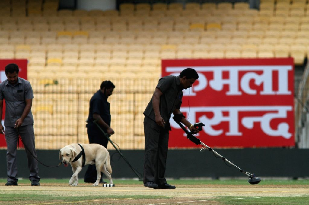 Bomb squad personnel inspect the cricket pitch in Chennai on Sept 16, 2017.