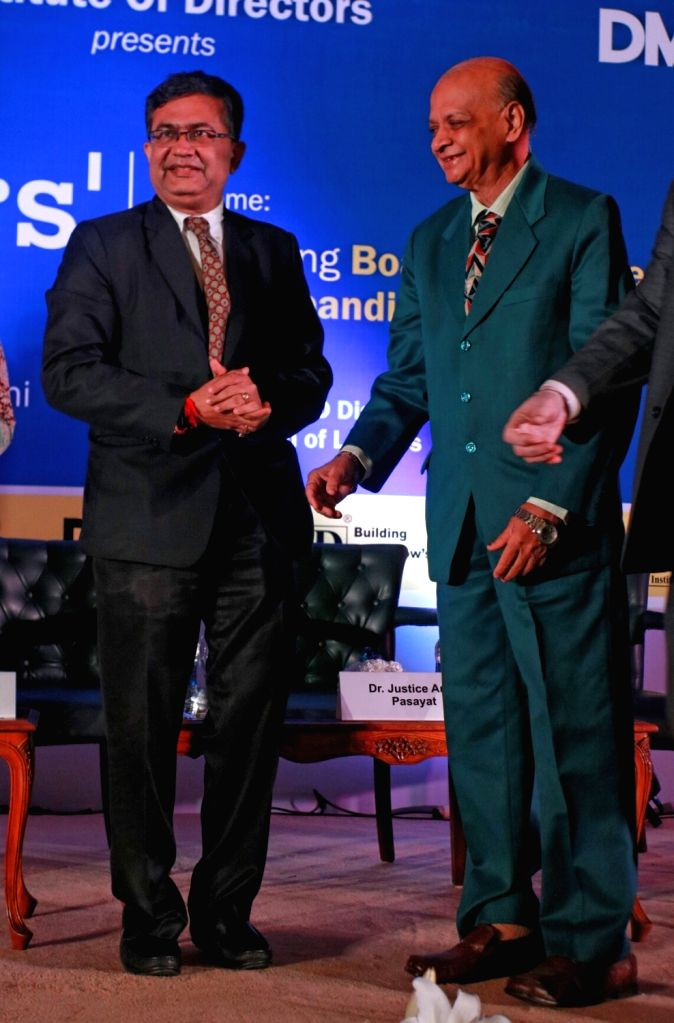 Bombay Stock Exchange MD and CEO Ashish Chauhan along with retired Supreme Court judge Arijit Pasayat during the Director's conclave 2017, in New Delhi on Aug 18, 2017. - Ashish Chauhan