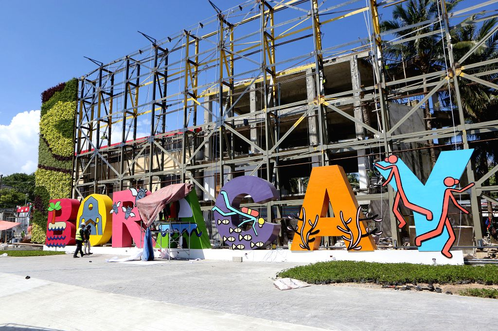 BORACAY ISLAND, Oct. 25, 2018 - A colorful signboard is seen as workers prepare for the opening ceremony of Boracay Island, the Philippines, Oct. 25, 2018. The world famous Boracay resort island in ...