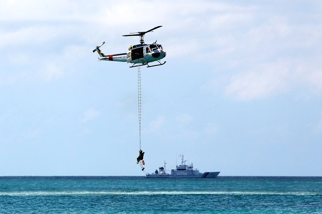 BORACAY ISLAND, Oct. 25, 2018 - A rescue helicopter from the Philippine Air Force (PAF) airlifts a rescued mock victim during a security capability demonstration along the beach in Boracay Island, ...
