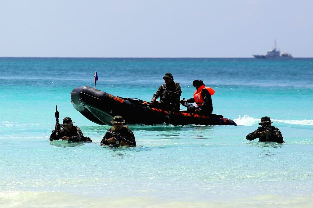 BORACAY ISLAND, Oct. 25, 2018 - Policemen from the Philippine National Police (PNP) Maritime Group participate in a security capability demonstration along the beach in Boracay Island, the ...