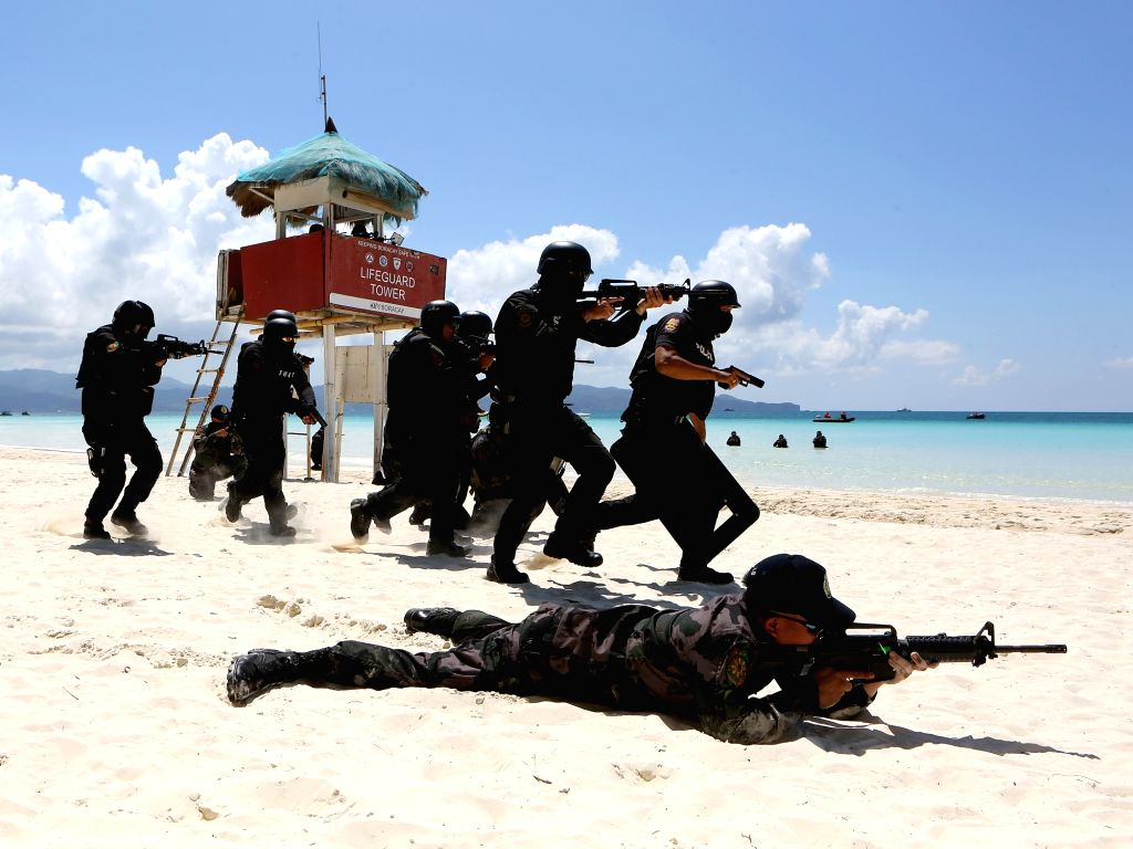BORACAY ISLAND, Oct. 25, 2018 - Policemen from the Philippine National Police Special Weapons and Tactics (PNP-SWAT) participate in a security capability demonstration along the beach in Boracay ...