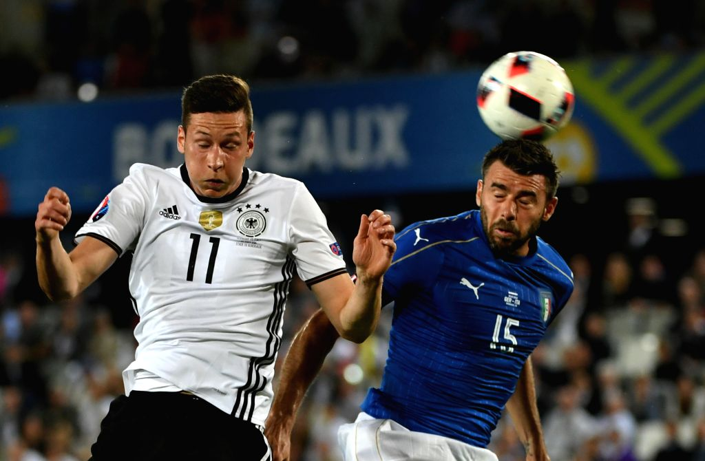 BORDEAUX, July 3, 2016 - Andrea Barzagli(R) of Italy vies with Julian Draxler of Germany during their Euro 2016 quarterfinal match in Bordeaux, France, July 2, 2016.