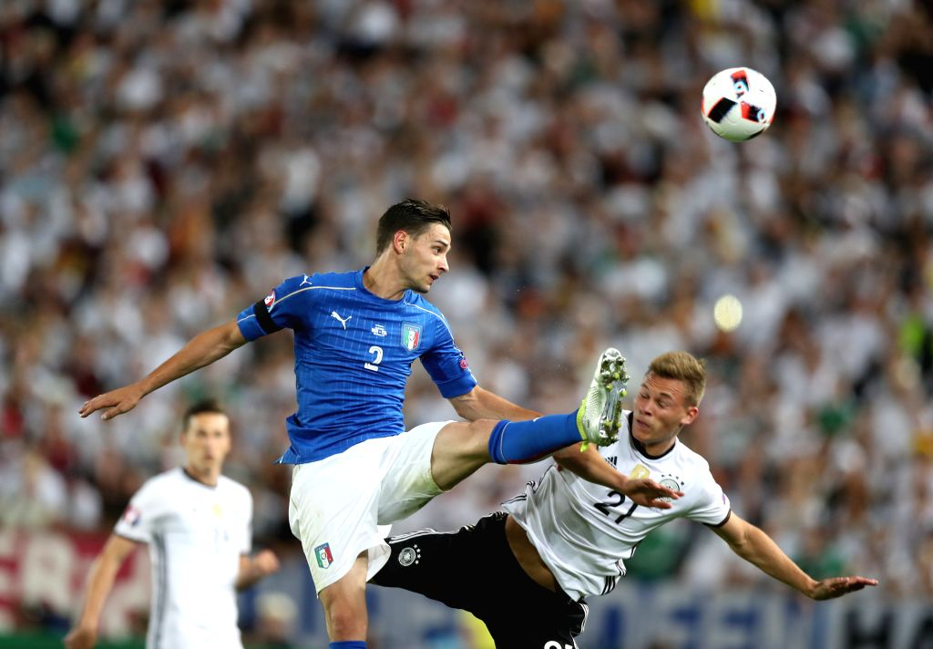 BORDEAUX, July 3, 2016 - Mattia De Sciglio(L) of Italy vies with Joshua Kimmich of Germany during their Euro 2016 quarterfinal match in Bordeaux, France, July 2, 2016.