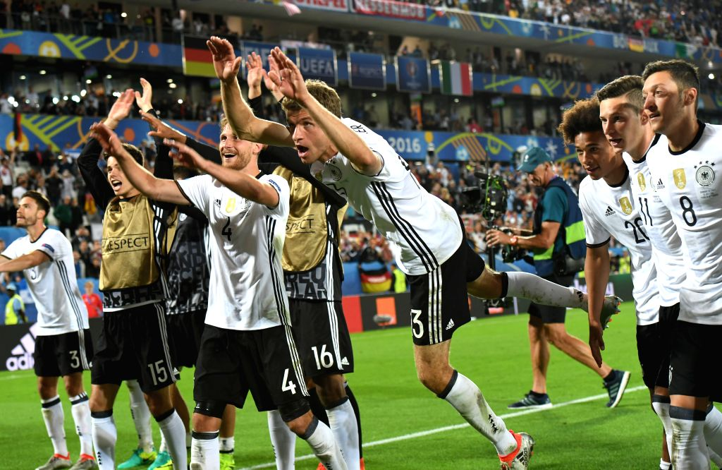 BORDEAUX, July 3, 2016 - Players of Germany celebrate victory after the Euro 2016 quarterfinal match between Germany and Italy in Bordeaux, France, July 2, 2016. Germany won the match with 7-6 after ...