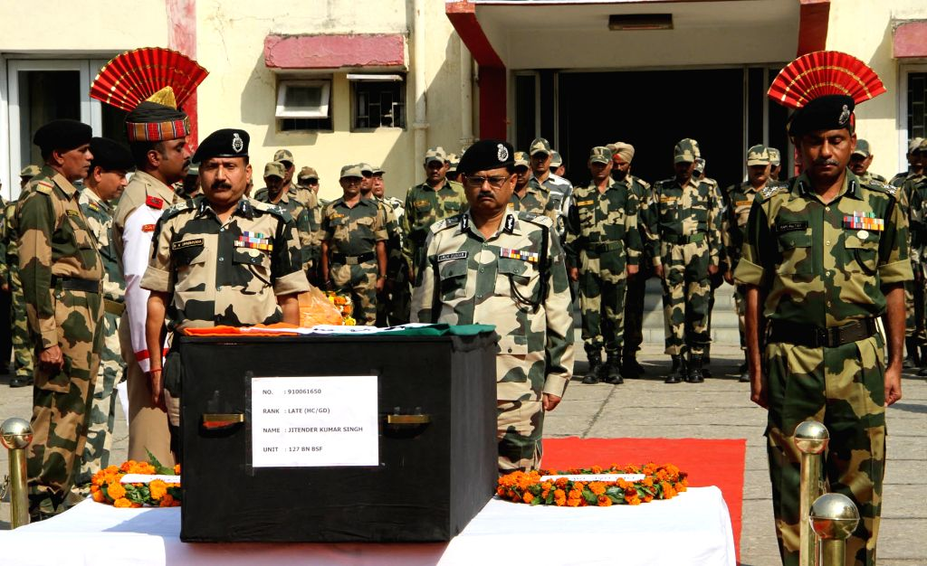 Border Security Force Additional Director General Arun Kumar pays tribute to martyr Jitender Kumar Singh who was killed in cross border firing at Line of Control between India and Pakistan; ... - Arun Kumar and Jitender Kumar Singh