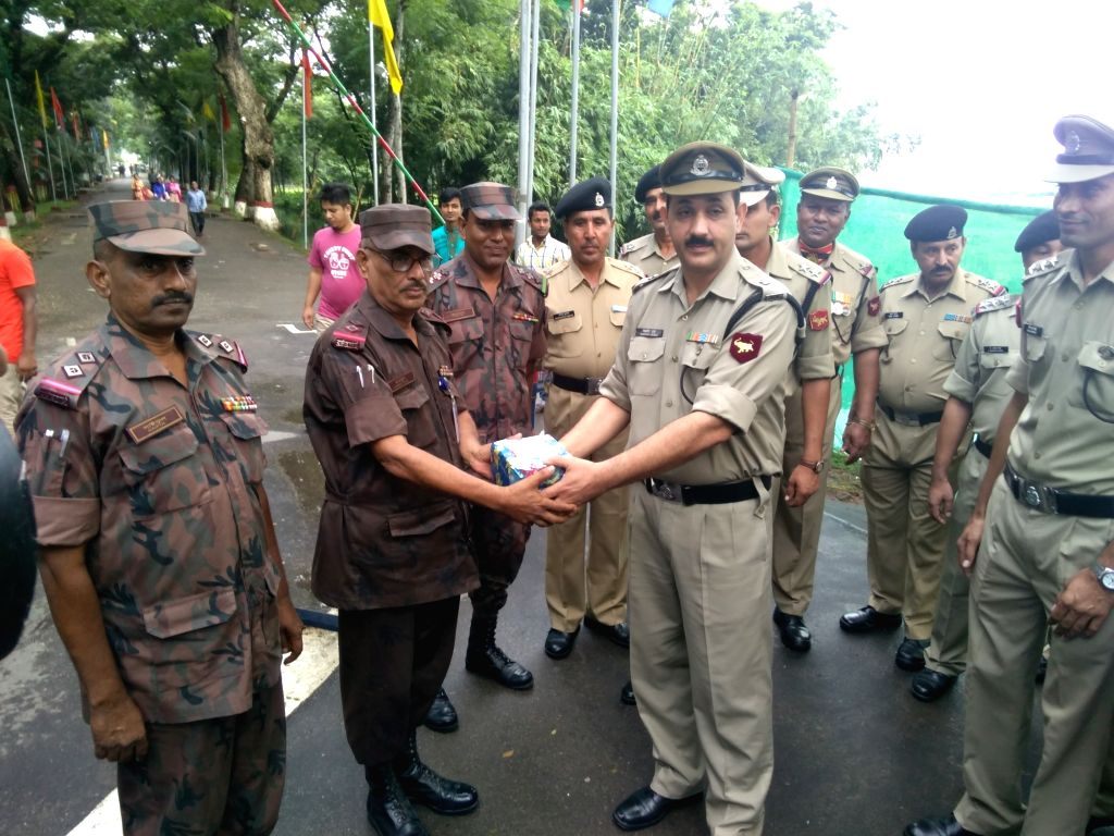 Border Security Force (BSF) and Border Guard Bangladesh (BGB) personnel exchange sweets on Independence Day of India at Akhaura Integrated Check Post (ICP) near Agartala,Tripura on Aug 15, ...