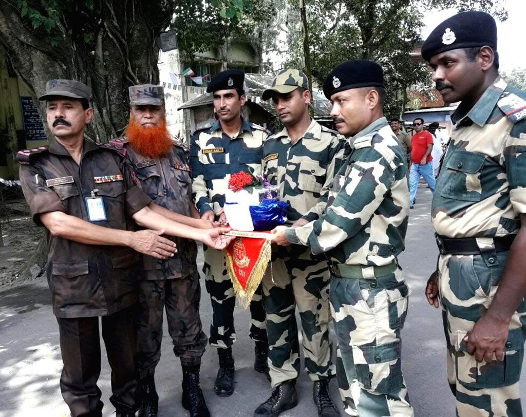 Border Security Force (BSF) and Border Guard Bangladesh (BGB) personnel exchange sweets on Independence Day of India at Hili in Dakshin Dinajpur district of West Bengal on Aug 15, 2016.