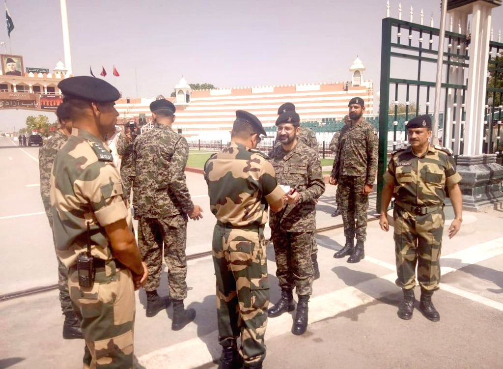 Border Security Force (BSF) and Pakistani Ranger officials exchange greetings on Eid-ul-Fitr, at Attari-Wagha border in Punjab, on June 5, 2019.
