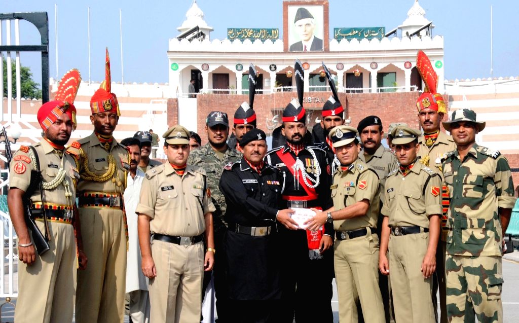 Border Security Force (BSF) officials exchange sweets with Pakistan Rangers on Independence Day of India at  Attari-Wagah border in Punjab on Aug 15, 2016.