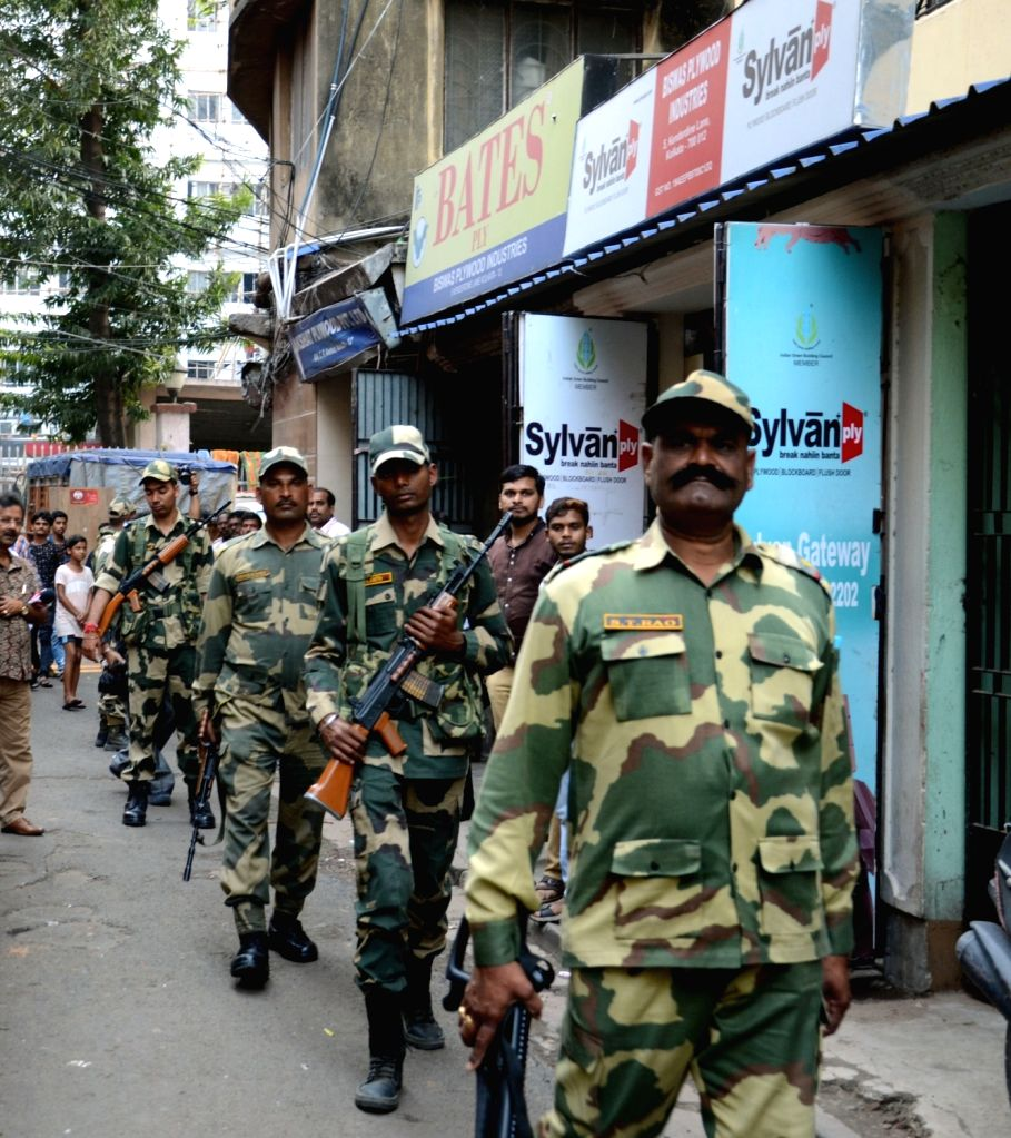 Border Security Force (BSF) personnel conduct route march in and around Central Avenue ahead of 2019 Lok Sabha elections in Kolkata, on March 16, 2019.