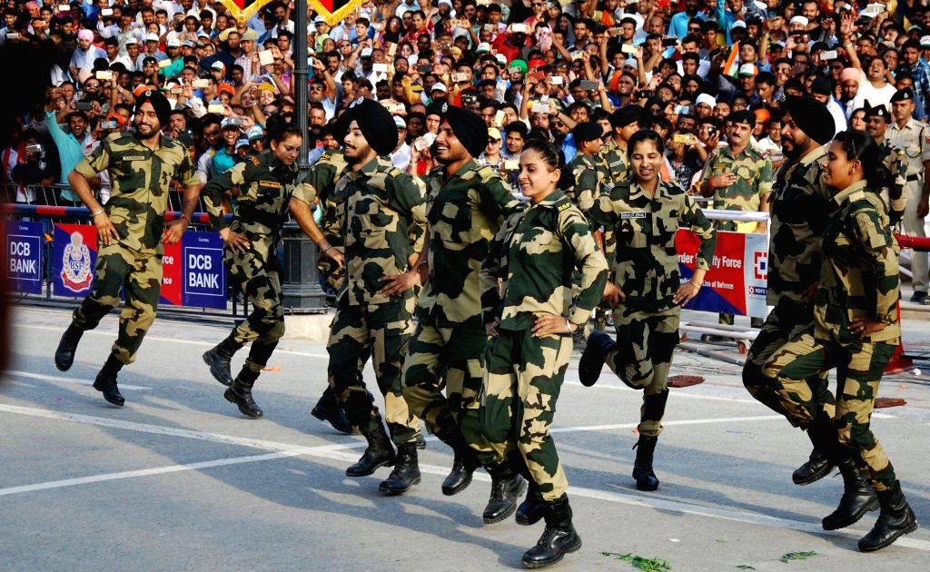 Border Security Force (BSF) soldiers perform the Bhangra during a ceremony to mark s Independence Day celebrations at the India-Pakistan Wagah border post near Amritsar on Aug. 15, 2017.