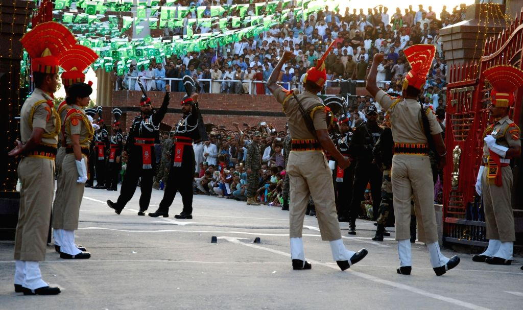 Border Security Force personnel and Pakistani Rangers perform during the daily beating of the retreat ceremony on India's Independence Day at Attari-Wagha border in Punjab, on Aug 15, 2017.