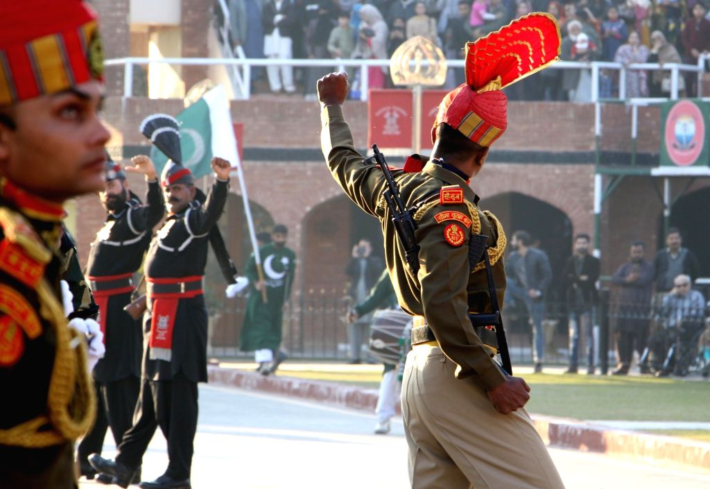 Border Security Force personnel and Pakistani Rangers personnel during the Beating Retreat ceremony at 71st Republic Day celebrations at the India-Pakistan border post at Attari, about 35 kms ...