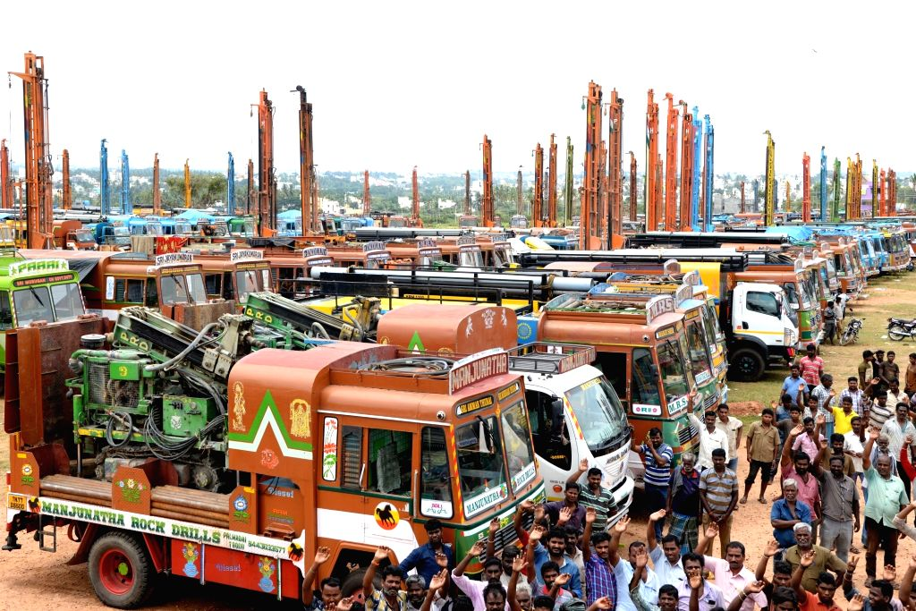 Borewell lorries parked at the outskirts of Kengeri by Karnataka Rig Owners Association to protest against rising fuel prices, in Bengaluru on Sept 16, 2018.