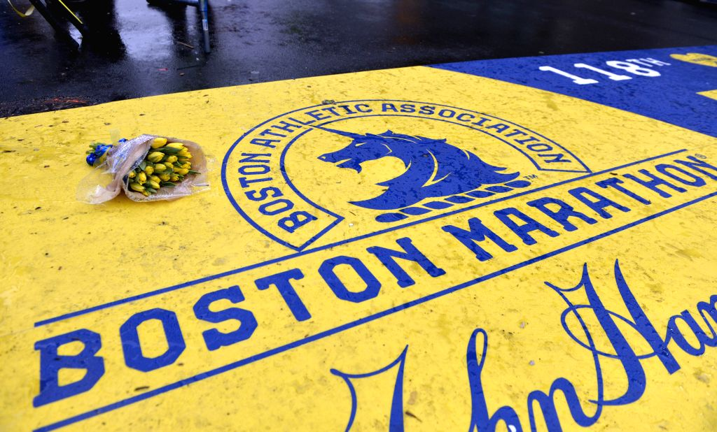 A bunch of flowers can be seen at the site where explosions occured during the 2013 Boston marathon, in Boston, Massachusetts, the United States, April 15, 2014. ...