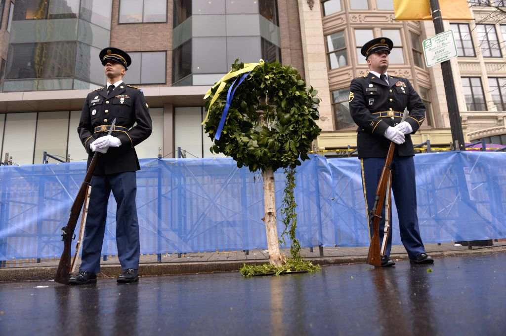 Policemen guard the site where explosions occured during the 2013 Boston marathon, in Boston, Massachusetts, the United States, April 15, 2014. Twin bombs placed in
